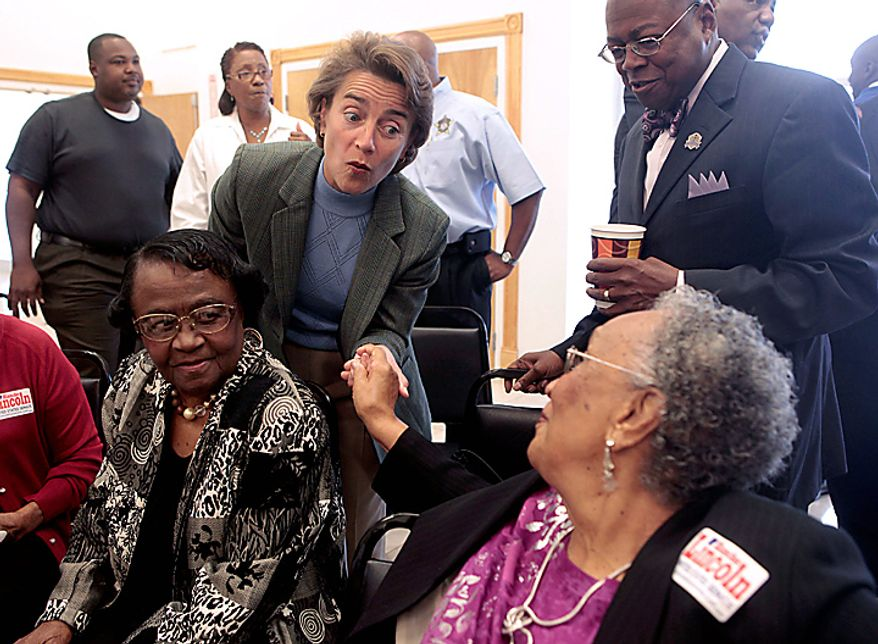 Sen. Blanche Lincoln, D-Ark., center, talks with supporters during a campaign stop in Pine Bluff, Ark., Monday, Nov. 1, 2010.  (AP Photo/Russell Powell)
