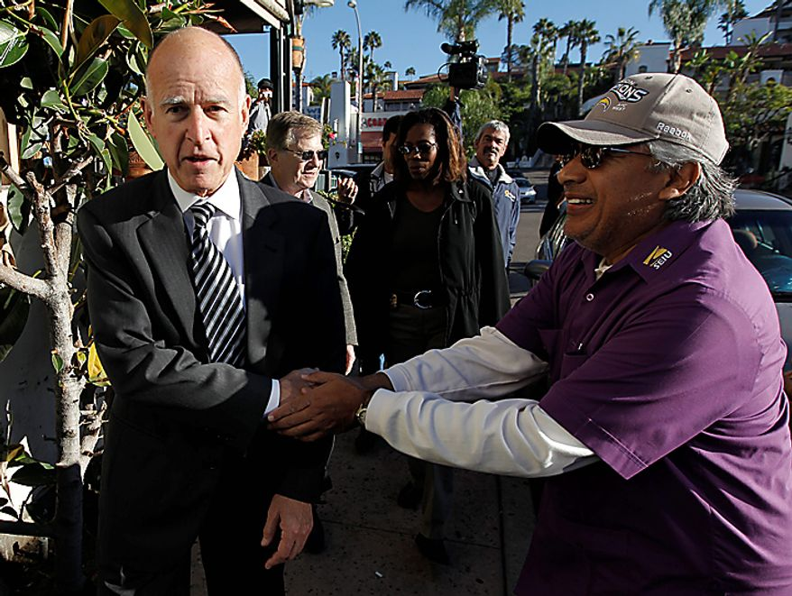 California Attorney General and Democratic gubernatorial candidate Jerry Brown greets supporters during a campaign stop at Cafe Coyote in San Diego, Monday, Nov. 1, 2010. (AP Photo/Chris Carlson)