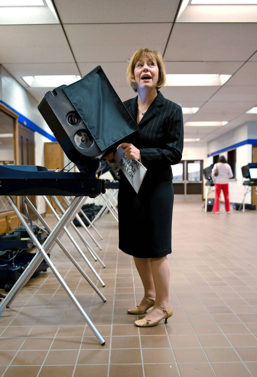 Sharron Angle, the GOP Senate candidate, reminds the media that voting is supposed to be private as she casts her vote in Reno on Tuesday. Mrs. Angle's gaffes included her remark to Hispanic high school students that some of them looked Asian and that the 9/11 terrorists entered through the Canadian border.