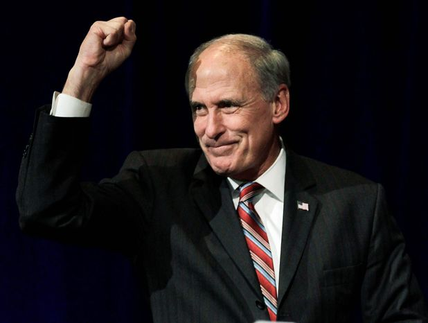 Associated Press Former Sen. Dan Coats, Indiana Republican, casts his ballot in Indianapolis on Tuesday, en route back to the Senate.