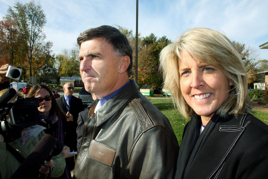 ASSOCIATED PRESS Republican former Gov. Robert L. Ehrlich Jr. and candidate for governor talks to reporters before voting in Annapolis, Md., with his wife, Kendel Ehrlich, on Tuesday.