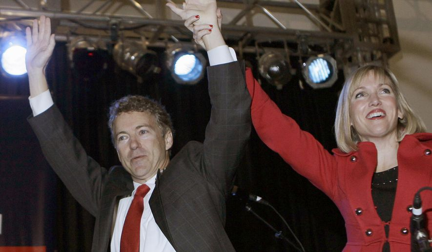 Sen.-elect Rand Paul, Kentucky Republican, and his wife, Kelley, arrive Tuesday at his victory celebration in Bowling Green, Ky. (Associated Press)