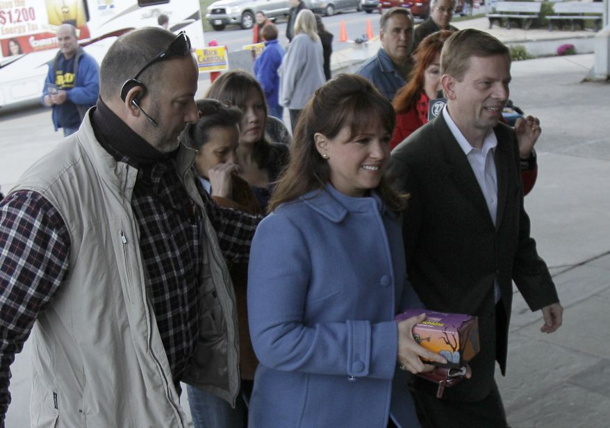 Delaware Republican U.S. Senate candidate Christine O'Donnell enters a polling place to cast her vote, Tuesday, Nov. 2, 2010, in Wilmington, Del. Miss O'Donnell is facing Democrat Chris Coons. (AP Photo/Rob Carr)