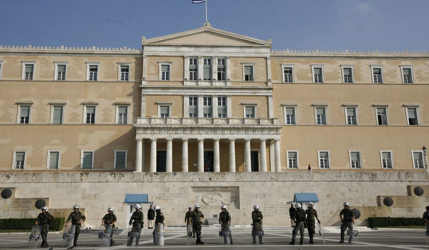 Police stand outside the Greek parliament after a controlled blast in Athens, Tuesday, Nov. 2, 2010. (AP Photo/Alkis Konstantinidis)