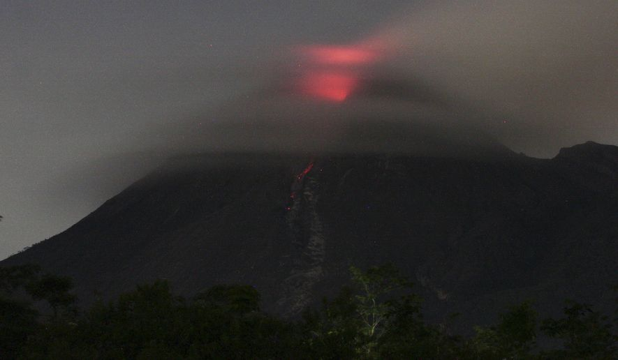 Lava glows at the crater of Mount Merapi as seen from Deles, Central Java, Indonesia, Tuesday, Nov. 2, 2010. Indonesia's most dangerous volcano forced international airlines to cancel flights to nearby airports Tuesday, as fiery lava lit the rumbling mountain's cauldron and plumes of smoke blackened the sky. (AP Photo)