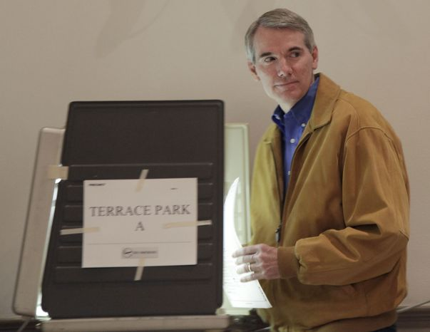 U.S. Senate candidate Rob Portman votes in his Terrace Park, Ohio, community building Tuesday Nov. 2, 2010. Portman, a Republican, is seeking the U.S. Senate seat now held by the retiring Sen. George Voinovich, Ohio Republican. (Associated Press)