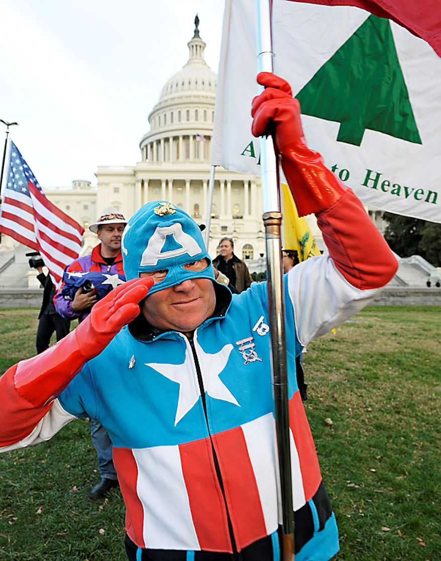 Tea Party Patriot, and Captain America, Jim Griffen, of Fort Washington, Md., takes part in an election day demonstration on the lawn of the Capitol in Washington, Tuesday, Nov. 2, 2010. (AP Photo/Cliff Owen)