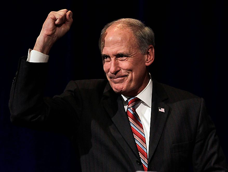 Indiana Republican candidate for the U.S. Senate Dan Coats pumps his first as he takes the stage to speak, Tuesday, Nov. 2, 2010, in Indianapolis, after defeating Democratic challenger Rep. Brad Ellsworth. Coats will take over the seat left vacant by Democrat Sen. Evan Bayh. (AP Photo/Michael Conroy)