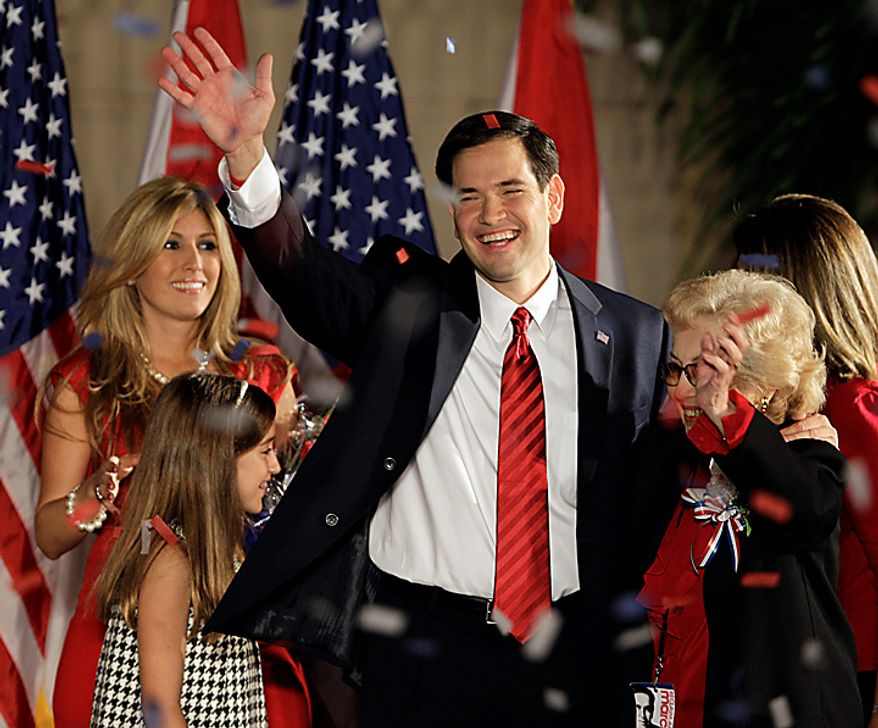 Republican Sen.-elect Marco Rubio hugs his mother Oria after thanking supporters in Coral Gables, Fla., Tuesday Nov. 2, 2010. To the left is his wife Jeanette and daughter Amanda. (AP Photo/Alan Diaz)