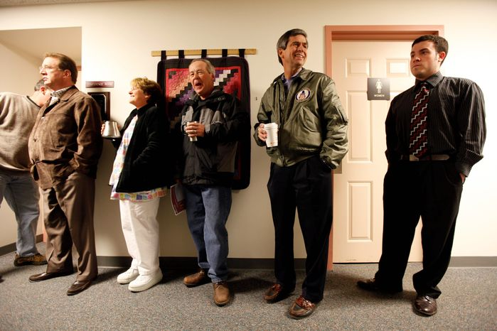 Rep. Joe Sestak, the Democratic Senate candidate in Pennsylvania (second right), waits in line to cast his ballot in Gradyville on Tuesday. (Associated Press photographs)