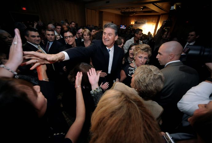 West Virginia Gov. Joe Manchin III (center) celebrates his win Tuesday in Charleston, W. Va. He assumes the Senate seat held for more than 50 years by Robert C. Byrd.