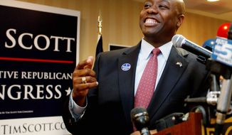 Tim Scott celebrates his victory on Tuesday. He will become the first black Republican congressman from South Carolina since Reconstruction. (Associated Press)