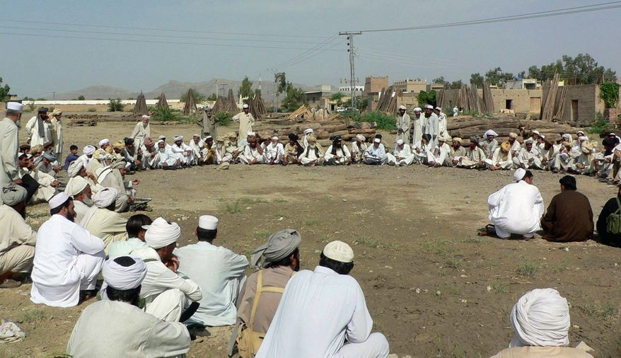 Pakistani tribal elders hold a jirga, or a grand meeting, in May in Mandi Bakka Kheil, near Bannu, Pakistan, to review the situation after Pakistan's government announced its intention to extend operations against the Taliban and militants in the North Waziristan tribal area. (Associated Press)
