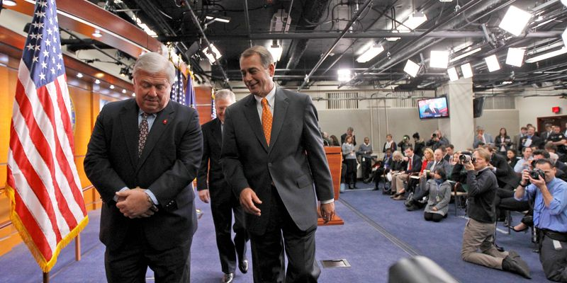 Republican Mississippi Gov. Haley Barbour (left) and presumed House Speaker-to-be Rep. John A. Boehner, Ohio Republican, leave a news conference on Capitol Hill on Wednesday, basking in the afterglow of the huge GOP gains in the House, Senate and governorships. (Associated Press)