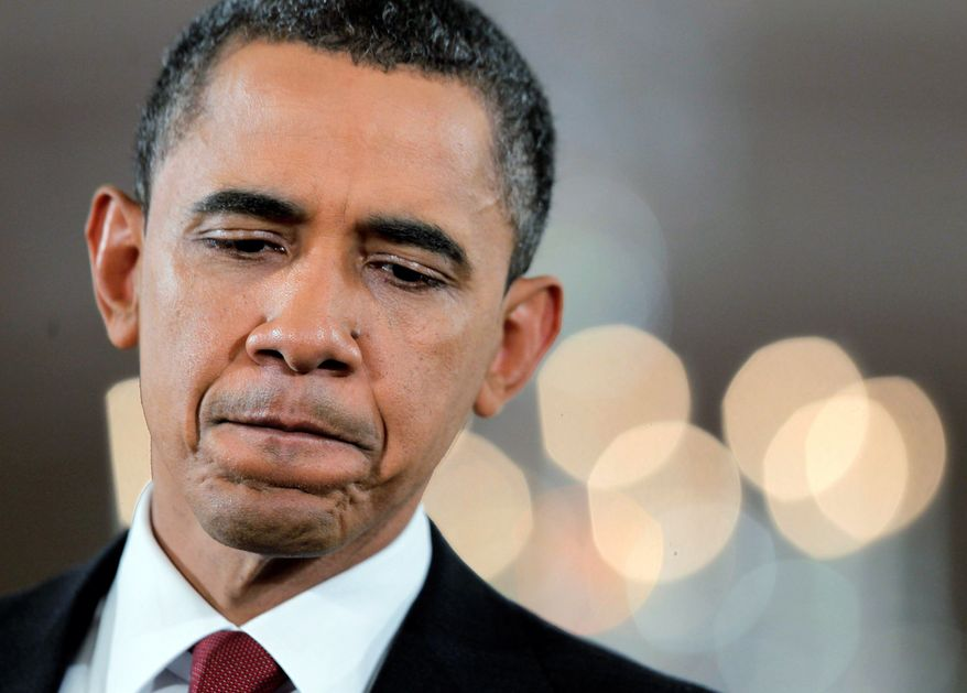 """VIEWS AT VARIANCE: In assessing Democrats' midterm congressional losses, a chastened President Obama said, """"We were in such a hurry to get things done that we didn't change how things got done. And I think that frustrated people."""" Mr. Obama wouldn't concede the blowout was a repudiation of his policies, but likely incoming House Speaker John A. Boehner, a Republican, is calling for a new direction. (Associated Press)"""