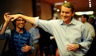 Senate candidate Michael Bennet, right, greets a supporter during an election night watch party in Denver, Tuesday, Nov. 2, 2010. (AP Photo/The Denver Post, Hyoung Chang)