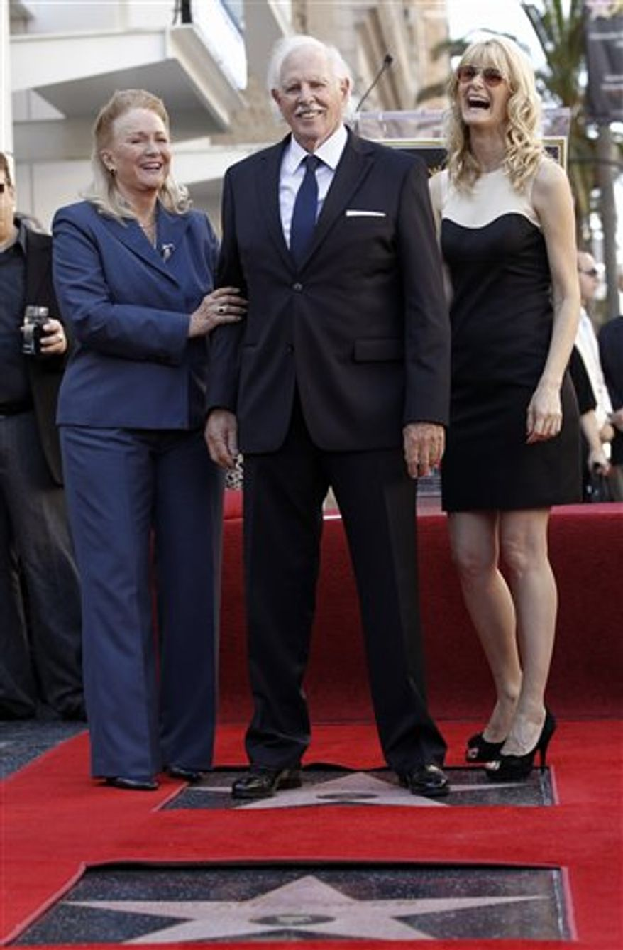Actress Diane Ladd, left, actor Bruce Dern, and actress Laura Dern pose after all received stars on the Hollywood Walk of Fame in Los Angeles, Monday, Nov. 1, 2010. (AP Photo/Matt Sayles)