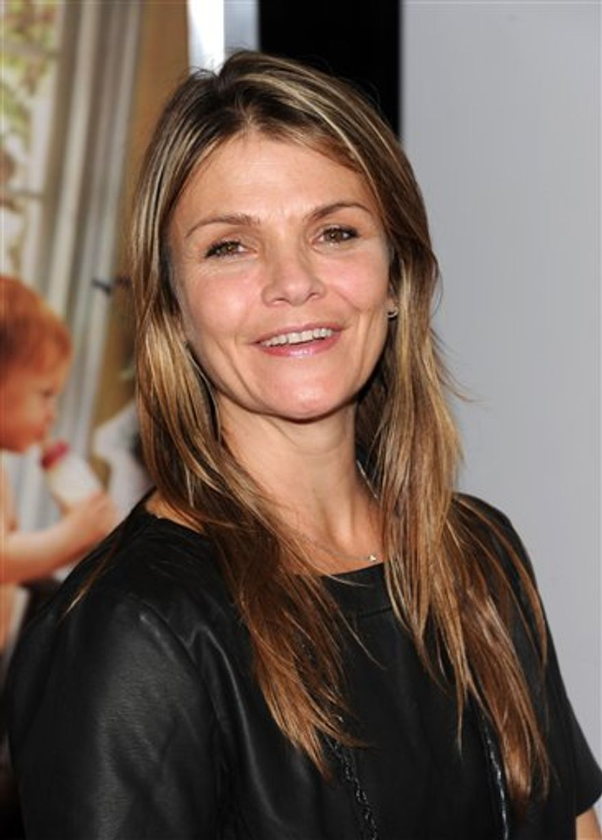 "In this Sept. 30, 2010 photo, actress Kathryn Erbe attends the premiere of ""Life As We Know It"" at The Ziegfeld Theatre in New York. Charles Nagel of Philadelphia is charged with interstate stalking, stemming from his ""obsession"" with Erbe, approaching her on filming locations and composing creepy missives about her on the Internet, a federal prosecutor said Tuesday, Nov. 2, 2010 in opening statements at his trial. (AP Photo/Peter Kramer)"