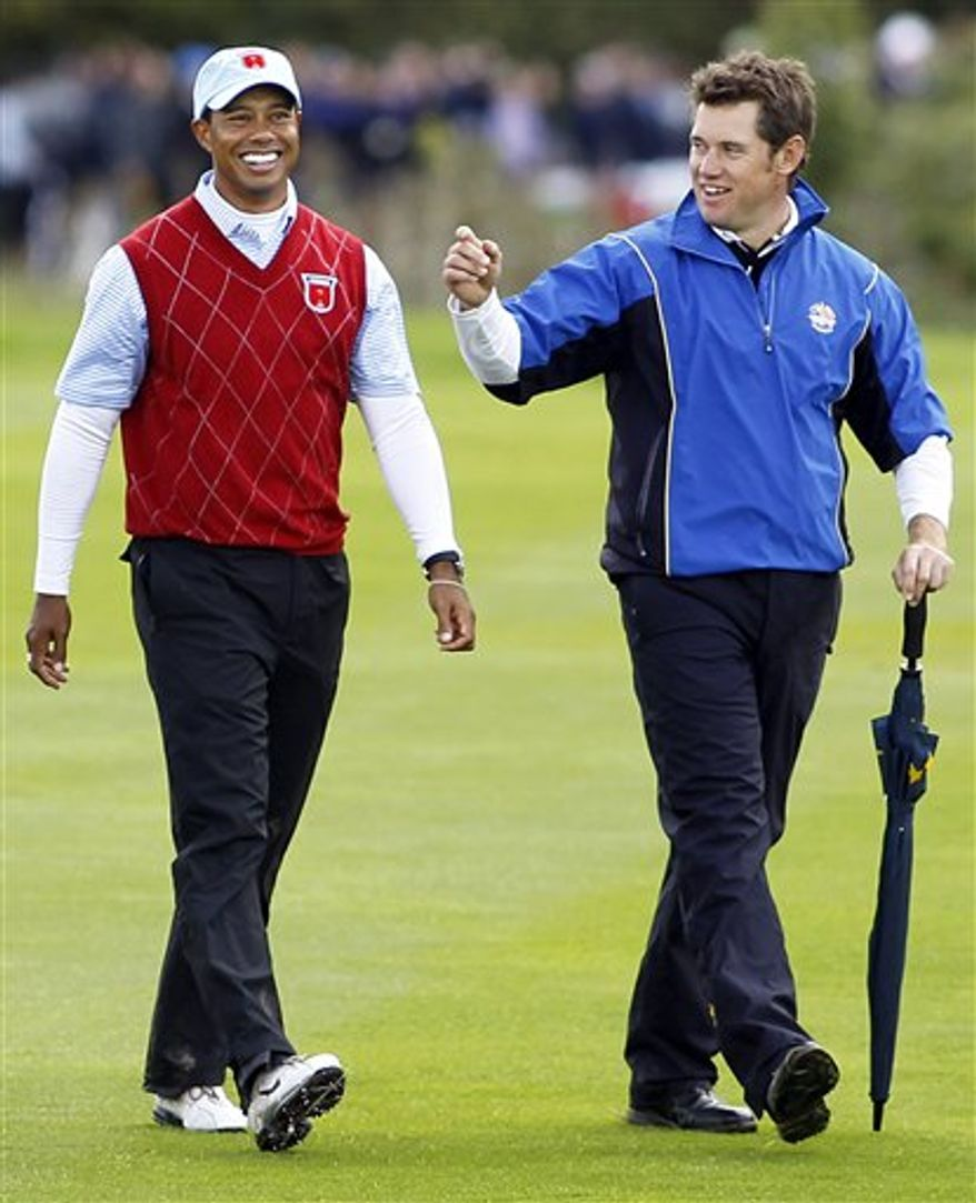 FILE -  This Oct.  3, 2010 file photo showa Tiger Woods, left, walking with Lee Westwood after finishing their match during the 2010 Ryder Cup golf tournament at the Celtic Manor Resort in Newport, Wales.  For the first time in more than five years, Woods is no longer golf's No. 1 player.  Westwood, of England, took the top ranking Sunday, Oct. 31, 2010 after PGA champion Martin Kaymer failed to finish among the top two at the Andalucia Masters in Spain. (AP Photo/Jon Super, file)