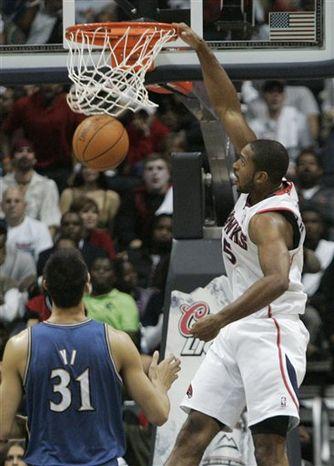 Atlanta Hawks center Al Horford, right, dunks in front of Washington Wizards power forward Yi Jianlian (31) during the second half of an NBA basketball  game, Saturday, Oct. 30, 2010, in Atlanta. The Hawks won 99-95. (AP Photo/John Amis)
