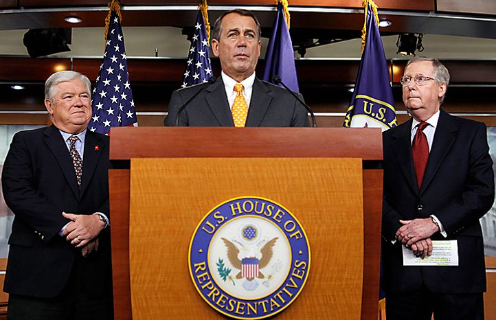House speaker-in-waiting Rep. John Boehner, R-Ohio, center, accompanied by Senate Minority Leader Mitch McConnell of Ky., right, and Mississippi Gov. Haley Barbour, speaks during a news conference on Capitol Hill in Washington, Wednesday, Nov. 3, 2010. (AP Photo/Alex Brandon)