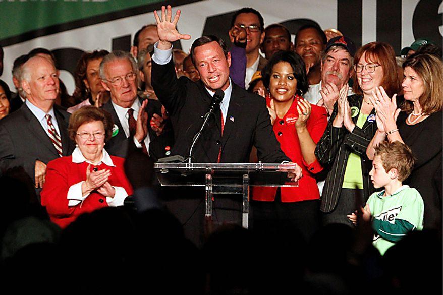 Maryland Democratic incumbent Gov. Martin O'Malley, center, celebrates his victory over former Republican Gov. Robert Ehrlich, in Baltimore on Tuesday, Nov. 2, 2010. (AP Photo/Jacquelyn Martin)