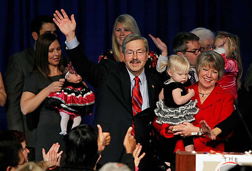 Iowa governor elect Terry Branstad, his wife Chris, right, and granddaughter Bridget celebrate with supporters during an election night rally, Tuesday, Nov. 2, 2010, in West Des Moines, Iowa. (AP Photo/Charlie Neibergall)