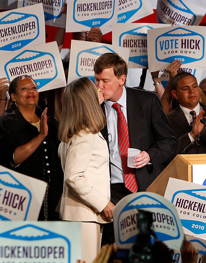 Democrat Colorado Gov.-elect John Hickenlooper kisses his wife Helen Thorpe at an election party in Denver, Colo., Tuesday, Nov. 2, 2010. (AP Photo/ Ed Andrieski)