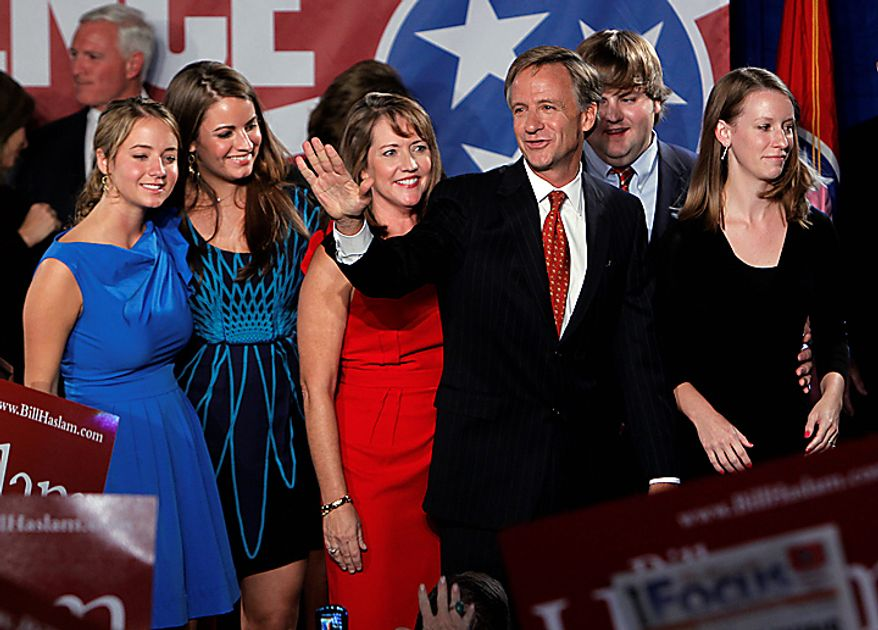 Republican gubernatorial candidate Bill Haslam leaves the stage with his family after speaking to supporters in Knoxville, Tenn., after he was named the winner in Tennessee's race for governor on Tuesday, Nov. 2, 2010. (AP Photo/Mark Humphrey)