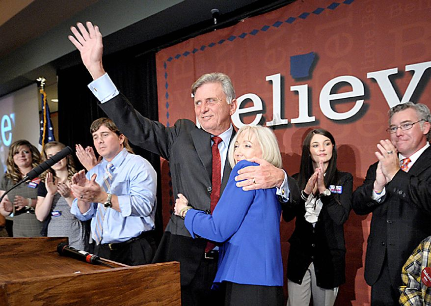 Arkansas Governor Mike Beebe, a Democrat, celebrates his re-election with his wife Ginger, right, at a victory party in Little Rock, Ark. Tuesday Nov. 2, 2010. (AP Photo/Brian Chilson)
