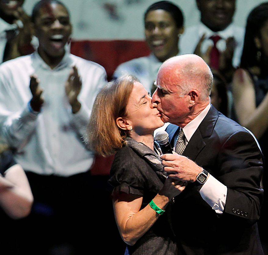 California Gov.-elect Jerry Brown celebrates his election win during a rally with his wife, Anne Gust, in Oakland, Calif., Tuesday, Nov. 2, 2010.  Brown defeated Meg Whitman, former CEO of eBay. (AP Photo/Paul Sakuma)