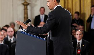 President Barack Obama gestures as he moves off stage at the conclusion of his news conference in the East Room of the White House in Washington, Wednesday, Nov. 3, 2010. (AP Photo/Pablo Martinez Monsivais)