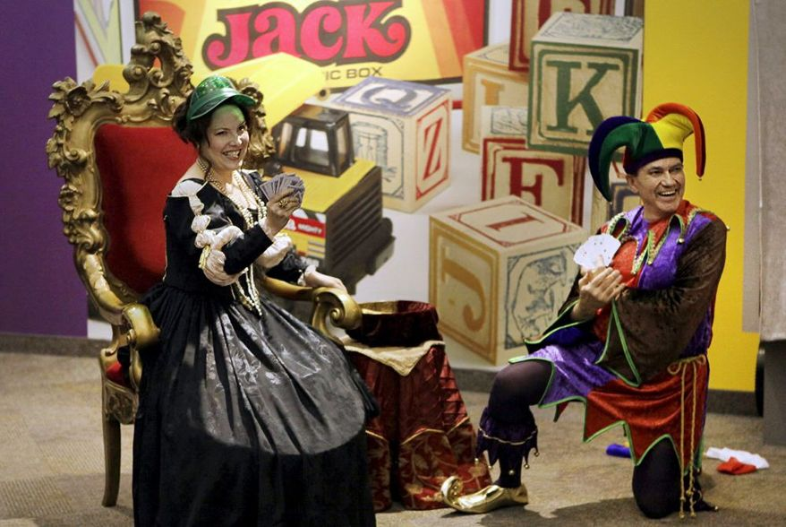At the Strong, a children's museum in Rochester, N.Y., a queen and a jester play cards. They celebrate card games, enshrined in the National Toy Hall of Fame on Thursday along with The Game of Life. (Associated Press)
