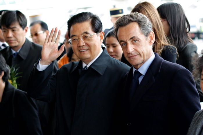 French President Nicolas Sarkozy welcomes Chinese President Hu Jintao at the Orly airport, south of Paris, on Thursday. The three-day state visit by Mr. Hu marks a dramatic turnaround from the tense ties of two years ago, when Mr. Sarkozy threatened to boycott the opening ceremony of the Beijing Olympics out of anger about China's treatment of Tibet. (Associated Press)
