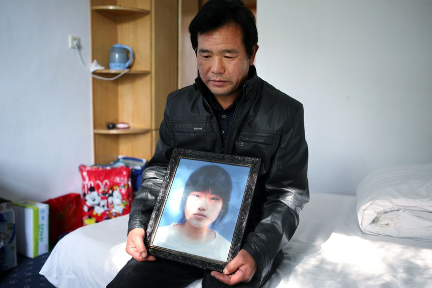 Chen Guangqian's daughter Chen Xiaofeng (in portrait) was the hit-and-run driver's victim. Her death last month crystallized popular outrage at abuses by China's elite. (Associated Press)