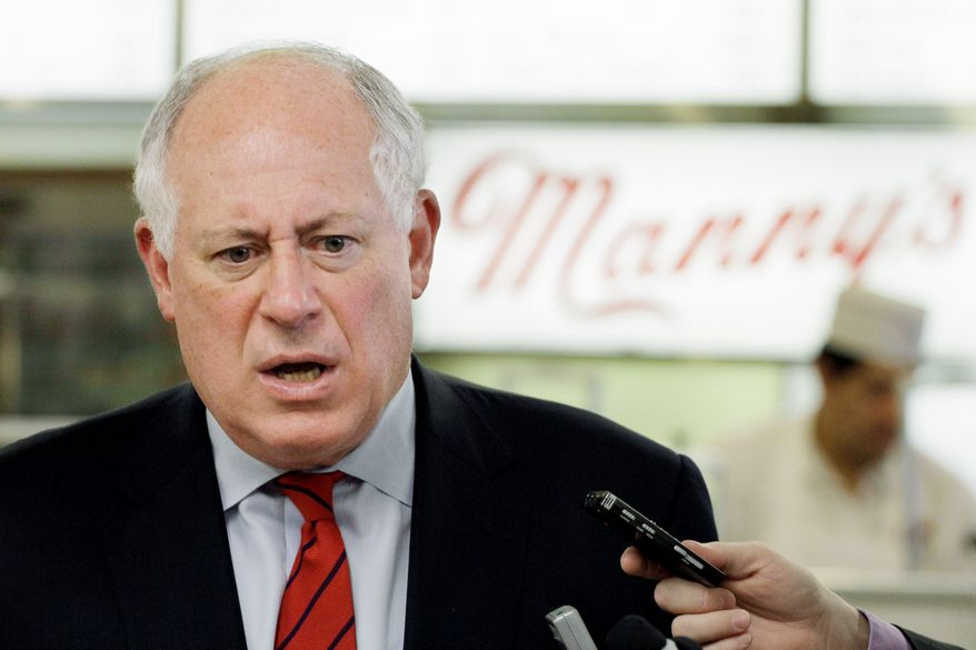 Illinois Gov. Pat Quinn talks to reporters Thursday in Chicago. Mr. Quinn's win was seen as sparing President Obama more embarrassment after Democrats failed to hold Mr. Obama's old Senate seat. (Associated Press)