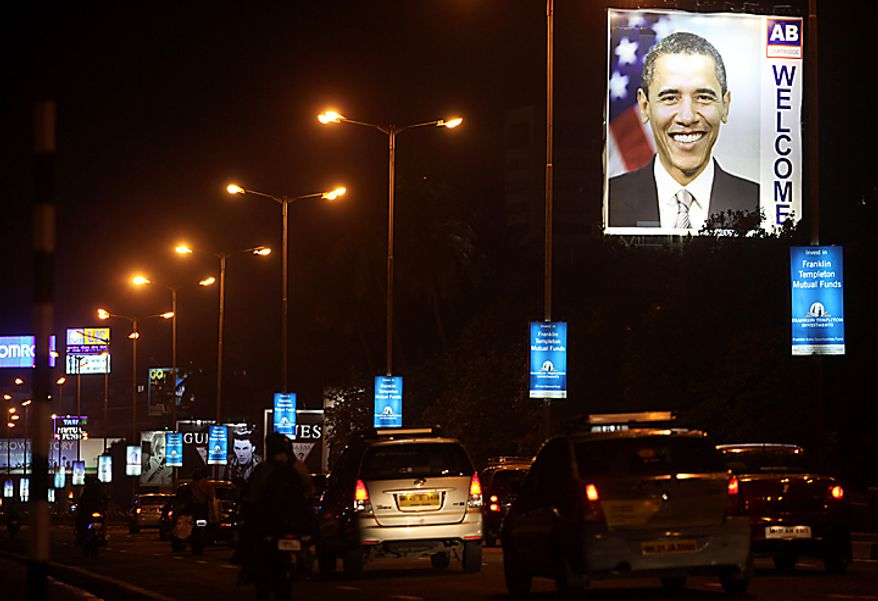 A billboard depicting U.S. President Barack Obama stands illuminated on a street in Mumbai, India, Thursday, Nov. 4, 2010. Obama is scheduled to visit India Nov. 6-9. (AP Photo/Rafiq Maqbool)