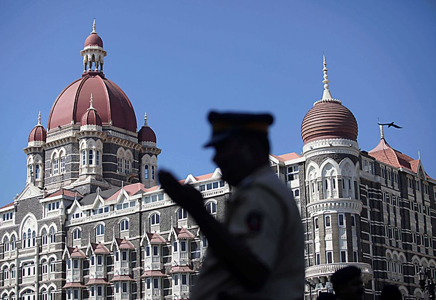 An Indian police officer stands guard outside the Taj Mahal hotel in Mumbai, India, Thursday, Nov. 4, 2010. President Barack Obama is scheduled to stay at the Taj on Nov. 6. The 107-year-old hotel reopened for business in August, nearly two years after it was attacked by terrorists in 2008. (AP Photo/Rafiq Maqbool)