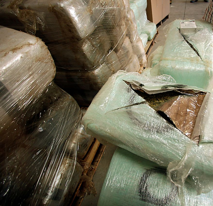 **FILE** An open bundle of marijuana seized at a warehouse in San Diego along the border between the United States and Mexico on Nov. 3, 2010, is seen here. A 600-yard tunnel was discovered in the warehouse. U.S. authorities found 20 tons of marijuana near the tunnel. (Associated Press)