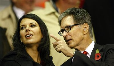 Liverpool co-owner John W. Henry applauds before his team's Europa League soccer match against Napoli at Anfield Stadium, Liverpool, England, Thursday Nov. 4, 2010. (AP Photo/Tim Hales)