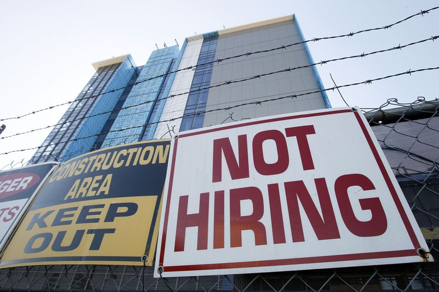 In this Nov. 4, 2010, photo, a sign turning away potential job-seekers is seen outside of a construction site in New Orleans. Employers added the most jobs in five months in October, with the education and health care sectors leading the way. But the unemployment rate, measured by a separate survey of households, refused to budge. It remained stuck at 9.6 percent for the third straight month. (AP Photo/Patrick Semansky)