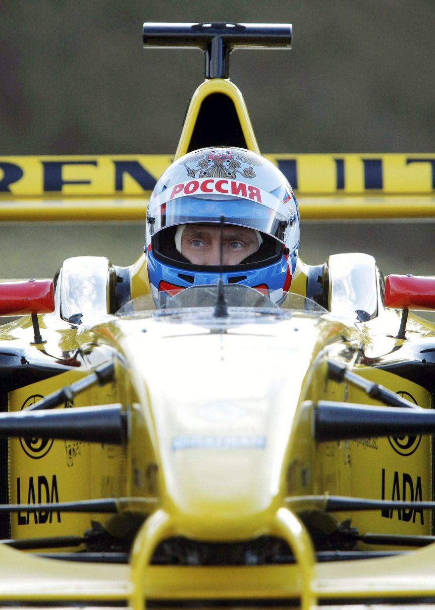 Russian Prime Minister Vladimir Putin prepares to drive a Renault racing car at a racetrack outside St. Petersburg, Russia, on Sunday. Mr. Putin tested his capacities as a Formula One driver. (Associated Press)