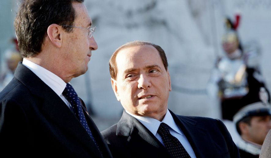 Italian Prime Minister Silvio Berlusconi (right) shares a word with Lower Chamber President Gianfranco Fini at a ceremony for Armed Forces Day at the Monument of the Unknown Soldier in Rome on Thursday. Mr. Fini is laying the foundation of a new party, challenging his ex-ally, Mr. Berlusconi, for the conservative vote. The two former allies split this summer after feuding over the government's program and the balance of power in the party they co-founded. Mr. Fini was effectively expelled by Mr. Berlusconi from the People of Freedom party. Mr. Fini is expected to turn his Future and Freedom movement into a formal party. (Associated Press)