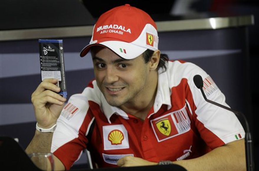Ferrari Formula One driver Felipe Massa, of Brazil, gives the thumb-up at the Interlagos racing track, in Sao Paulo, Brazil, Thursday, Nov. 4, 2010. The Brazilian Formula One Grand Prix will be held in Sao Paulo on Sunday. (AP Photo/Luca Bruno)