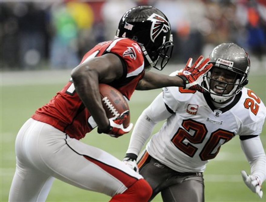 Atlanta Falcons wide receiver Roddy White (84) celebrates with team owner Arthur Blank as time expires in their 28-21 win over Tampa Bay Buccaneers of an NFL football game in Atlanta, Sunday, Nov. 7, 2010. (AP Photo/John Bazemore)