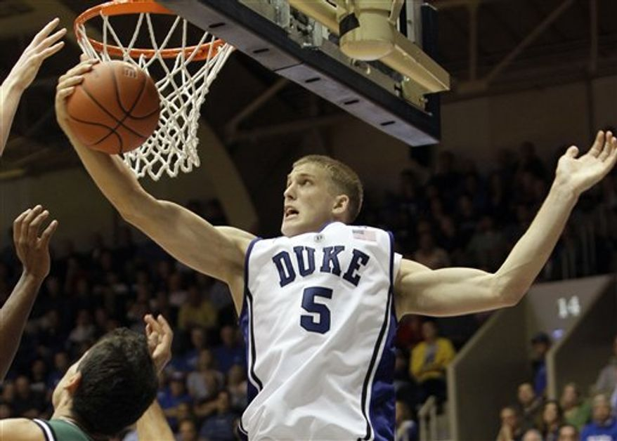 Duke's Mason Plumlee (5) pulls down a rebound against Cal Poly Pomona during the second half of an NCAA exhibition college basketball game in Durham, N.C., Thursday, Nov. 4, 2010. Duke won 81-60. (AP Photo/Gerry Broome)