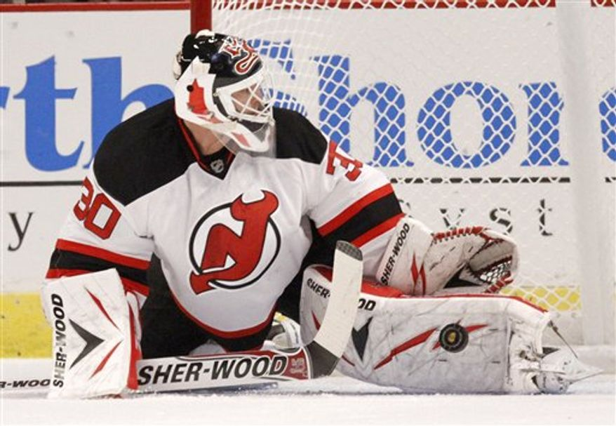 New Jersey Devils goalie Martin Brodeur blocks a shot during the first period of an NHL hockey game against the Chicago Blackhawks on Wednesday, Nov. 3, 2010, in Chicago. Brodeur was taken out of the game after the first period with an injury. (AP Photo/Brian Kersey)