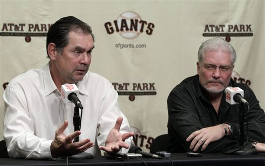 San Francisco Giants genaral manager Brian Sabean, right, and manager Bruce Bochy, look on during a baseball news conference in San Francisco, Friday, Nov. 5, 2010. (AP Photo/Jeff Chiu)