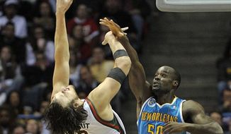 Milwaukee Bucks' Brandon Jennings, left, guards New Orleans Hornets' Chris Paul, right, who drives to the basket during the first half of an NBA basketball game Saturday, Nov. 6, 2010, in Milwaukee. (AP Photo/Jim Prisching)