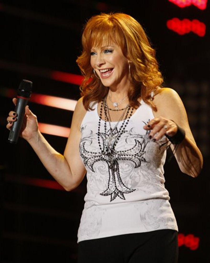 FILE - In this June 11, 2010 file photo, country singer Reba McEntire performs during the CMA Music Festival at LP Field in Nashville, Tenn. Country music's most recognizable woman is up for just one award at the Country Music Associaton Awards, but she inspired and led the way for the new generation of female talent that swept through nominations this year. (AP Photo/Wade Payne, File)